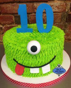Green one eyed monster cake