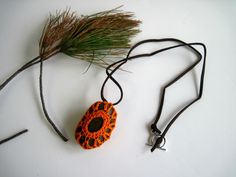 Crochet Natural Stone Pendant in Orange, via Etsy