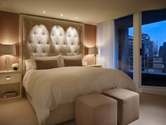 Stunning bedroom. All of these neutral colors tie so well together to make for a very relaxing bedroom. The floor to ceiling headboard is beautiful too. Follow us @Porchdotcom for only the best home inspiration on Pinterest ♥ Click to see the rest of this glamorous high rise apartment in Seattle!