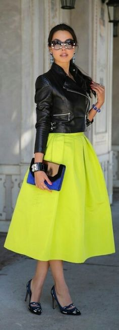 Love this whole outfit: the bright, feminine skirt, moto jacket, cool glasses