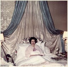 Queen Elizabeth II in bed after the birth of Prince Edward, 1964.
