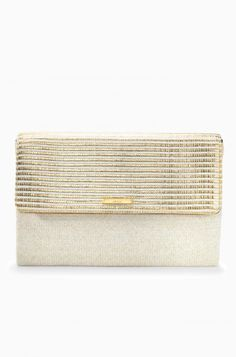 Dress up this gold clutch or dress it down - either way it will be with you all spring and summer. Shop the City Slim Clutch in Gold Stripe by Stella & Dot.