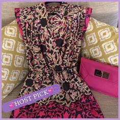 Beautiful Silky Blk and Hot Pink Dress Beautiful dress that is silkly material and nice and light. Perfect for a cool summer night. The dress has as a cross over top and elastic cinched waist.  Excellent condition. Dresses