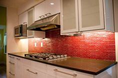 Kitchen. Cool Modern Under Cabinet Range Hood Design To Creates Healthy Kitchen. Astounding White IKEA Kitchen Cabinet With Red Mosaic Tiles Backsplash And Stainless Steel Modern Under Cabinet Range Hood Design Also Black Granite Counter Top Combination Design. Great kitchen cabinet in white with red backsplash tiles decoration plus black granite counter top and stainless steel under cabinet range hood. Awesome!.