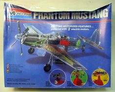 Monogram 5701.  motorized PHANTOM MUSTANG.  1:32.  1979 original issue.  powered by two electric motors (included).  fuselage and wings are molded in clear plastic to view the workings of the aircraft.  includes base: press button to spin prop; press button to operate landing gear; pull lever to release bombs.  other parts molded in red; green; silver and black.  box is pushed in along the top.  mint and factory sealed.  monogram-phantommustang.JPG (597×479)