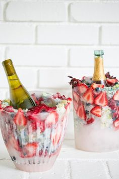 Keeping Champagne and wine chilled has never look better with these charming DIY floral ice buckets! They're colorful, festive and can be fully customized. Imagine kiwis, apples and flowers! They look beautiful sitting on a table and are perfect for summer entertaining. We love how they came out! See the how-to below. Cheers to DIY ice buckets!! …