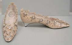 Wedding shoes House of Dior (French, founded 1947) Designer: Roger Vivier (French, 1913–1998) Date: 1956 Culture: French Medium: silk, leather, nylon, glass, metallic thread Dimensions: Length: 10 in. (25.4 cm) Height (of heel): 1 3/8 in. (3.5 cm) Credit Line: Gift of Valerian Stux-Rybar, 1979 Accession Number: 1979.472.21a, b