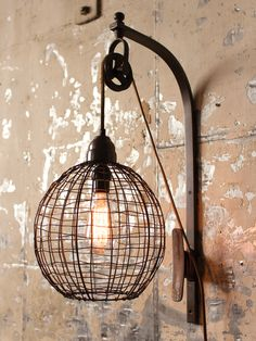 """recalling the early materials of the industrial revolution, the wire sphere wall sconce with a fantastic pulley mechanism, by Kalalou, will add interest beside the bed, mirror or in a hallway needing a lift. this rustic, metal wire and wood sconce is an inspired reminder of days past and present.  - one 40 watt max bulb, (bulb not included)  dimensions: 16"""" deep x 16""""w x 26"""" h"""