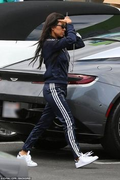 Kourtney Kardashian wearing Adidas Stan Smith Sneakers in White/navy, Adidas Originals Cigarette Pants in Legend Ink and Adidas Originals Sst Jacket in Legend Ink