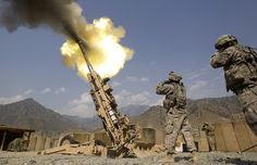 A 155mm round is fired from a 777 Howitzer canon at insurgents during a firing mission by soldiers with 2nd Platoon, Charlie Battery, 3rd Battalion, 321 Field Artillery Regiment out of Fort Bragg, N.C., Friday, July 8, 2011 at Forward Operating Base Bostick in Kunar province, Afghanistan. AP / David Goldman Read more here: http://blogs.sacbee.com/photos/2011/08/visual-dispatches-from-the-hel.html#storylink=cpy
