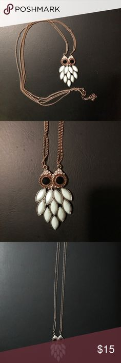 """Long owl necklace Great condition, though there are a few kinks in the chain.  Owl's feathers are sea green faceted glass, eyes are faceted black glass, surrounded with clear rhinestones.  Owl measures 1.5"""" across at widest point, 2.5"""" in length.  Chain is 33"""" with 3.5"""" extender. Jewelry Necklaces"""
