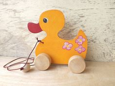 Wooden pulling toy Duck in orange handmade wooden toys for