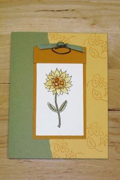 Sunflower greeting card with ink stamped background leaves, water colored sunflower and metal embellishments by Michelle Dixon, Stampin' Up!