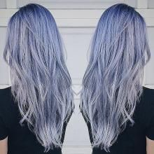 This client has natural level 2 Asian hair and came in with a few inches of regrowth and blue direct dye. She loved the blue but wanted something more subtle. Stylist James Miju (@dearmiju) responded with this ethereal silver-blue.