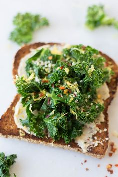This Hummus Kale Toast is a delicious gluten free & vegan breakfast or snack! Flavors like garlic, lemon, & red pepper flakes put the flavor over the top!