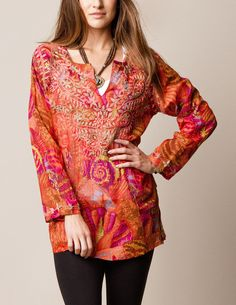 Loose-fitting, feminine, and flowy, this tunic is perfect for a casual day in the park... Using complementary colors, the hand-embroidery over the chest area...