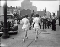 Two women show uncovered legs in public for the first time in Toronto, 1937.