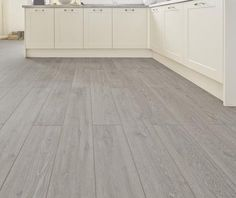 Kitchen Flooring Ideas - This Professional V Groove Light Grey Oak laminate flooring goes in hand perfectly with our Burford Matt Ivory kitchen. For more inspiration, speak to your local builder or visit Howdens. Wooden Kitchen Floor, Grey Wooden Floor, Laminate Flooring In Kitchen, Ivory Kitchen, Slate Kitchen, Bathroom Flooring, Modern Flooring, Best Flooring, Grey Flooring