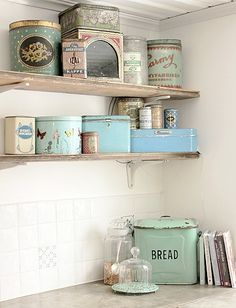 Love this display of vintage tins. Make sure to keep collections together, so they don't look like clutter. Biddy Craft