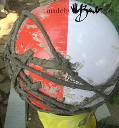 Concrete Garden Orbs – Made By Barb – Simple DIY portland cement dipped yarn or fabric formed over inflated balls or balloons – Diy Garden Concrete Yard, Cement Garden, Cement Art, Cement Planters, Concrete Crafts, Concrete Projects, Concrete Leaves, Concrete Design, Art Projects