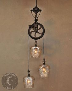This beautiful version of our most popular fixtures features a pulley wheel, brass body and three bottles of your choice. To purchase this fixture with the Crown Royal bottles, simply order it here from the website. Rustic Pendant Lighting, Rustic Lamps, Pendant Chandelier, Industrial Lighting, Home Lighting, Chandelier Lighting, Kitchen Lighting, Lighting Ideas, Vintage Lighting