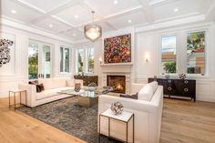 Formal living room with a fireplace for grand entertaining.
