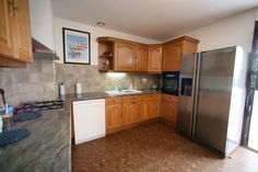 kitchen with american fridge with filtered water on tap & ice, the kitchen is fitted out with dishwasher, gas hob, electric fan assisted oven, microwave & dishwasher. The washing machine & tumble drier are downstairs in the laundry room