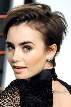 Lilly Collins shows a pixie cut can be both punky and sweet with plenty of texture and longer layers. This style is all about the product.