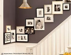 This purple/slate gray paint mixed with the black, white, and gray frames looks great.  I like the way the pictures cascade up the stairs haphazardly and not in a perfectly balance way.  Found at Pottery Barn.