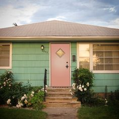 I think I might faint! Awesome pink crestview door on an aqua mid century house...swoon!!! crestviewdoors.com