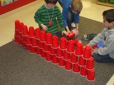 cup stacking with 100 cups on the day of school- my idea- work on motor skills using these cups! This would be great practice for those kids who grip hard. 100 Days Of School, Too Cool For School, School Fun, Preschool Math, Kindergarten Math, Activities For Kids, Valentine Activities, 100s Day, Block Area