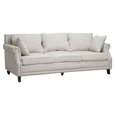 Upholstered birch wood sofa with nailhead trim.    Product: Sofa   Construction Material: Linen, foam and birch wood