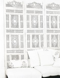 White rooms. White screen. Old panels as headboard