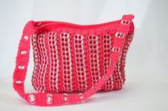 Hot pink crocheted recycled can tab pop top purse.
