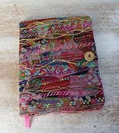 Original one of a kind quilted, embellished and embroidery composition notebook cover.    This cover fits a standard size composition