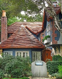 this house looks like it should be sitting on the coast in carmel-by-the-sea. awesome whimsical roof.