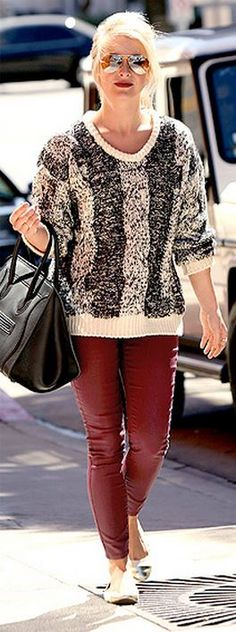 Who made  Julianne Hough's black tote handbag and red skinny jeans?