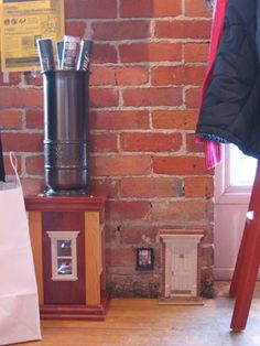 Urban fairy door... this is where the original downtown urban-fairy fairy door reappeared after disappearing from its original location on the outside of Sweetwaters Coffee & Tea in Ann Arbor, MI.