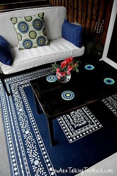 Want to fancy up your outdoor space? What about a stenciled rug on the concrete!