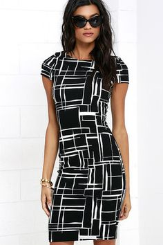 """While the Long and Drawn Out Black Print Midi Dress is worth waiting for, you can have it on your doorstep in no time! A textured ivory stretch knit forms a curvy bodycon look with black lines """"drawn"""" throughout, and short cap sleeves. Rounded neckline. Hidden back zipper."""