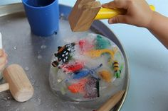 Freeze plastic toys in a bowl of water and give kids tools to break the toys free.  Great outdoor activity when it's hot.
