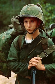 A young Marine waits on the beach during the Marine landing at Da Nang, Vietnam, on August 3, 1965.