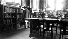 1920's: Young and old, rich and poor were invited to use the library and its riches. These young ladies searching the Children's Book shelves were obviously dressed up for a trip downtown.