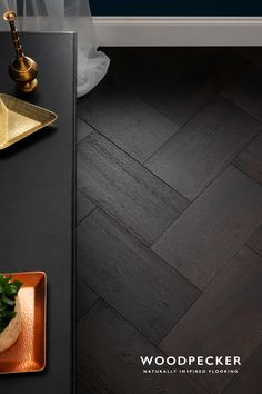 This chunky parquet floor revels in the beauty of darkness. Get a free sample at our website.