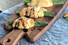 Roasted Asparagus wrapped with buttery Pillsbury Crescent Rolls and topped off with a sweet Balsamic Reduction Drizzle. One word... heaven!