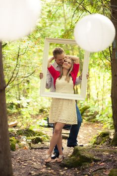 North West Toronto Engagement Session   Kornelia and Bart   Making good use of props during their engagement photography. Loving how this couple posed with the white frame #torontoengagementphotographer #engagement #engagementphoto ~ http://www.focusproduction.ca/toronto-engagement-photography/kornelia-bart-2/
