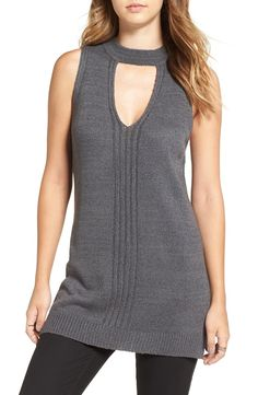 An exaggerates split hem relaxes the silhouette of this layer-friendly sleeveless sweater styled with daring front and back keyholes.