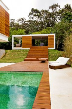 #wood architecture #architecture in brazil #wood #wood designs #pool #outdoor pool #wood deck #nature vs man #man in nature #architecture in nature #house in the woods #pool chairs #modern pool #modern outdoor pool #we like it!
