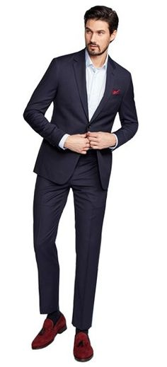 The Hartford's deep neutral color and subtle linear pattern strikes the perfect balance of professional and fashion-forward in a navy suit. After all, you have to draw the fineline somewhere.