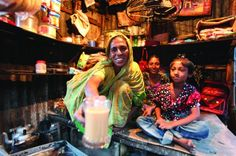 Shyamola from Bangladesh in her tea stall with her two daughters. Until I became destitute, I had never imagined I could run a business, she says. Photo: Salman Saeed/UNDP Bangladesh